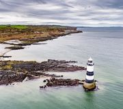 Aerial view of Penmon point lighthouse , Wales - United Kingdom. Aerial view of Penmon point lighthouse on Anglesey , Wales - United Kingdom Royalty Free Stock Photos