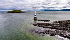 Aerial view of Penmon point lighthouse , Wales - United Kingdom. Aerial view of Penmon point lighthouse on Anglesey , Wales - United Kingdom Stock Image