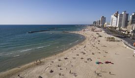 Aerial view of people bathing in the sun on Tel Aviv beach. kite surfer gliding across blue ocean, israel. Aerial view of people bathing in the sun, swimming and stock photos