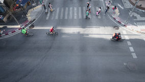 Aerial view of People and bicycle are going across crosswalk. Royalty Free Stock Photos