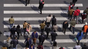Aerial view of people on busy pedestrian crossing, Shanghai stock video footage
