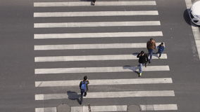 Aerial view of people on busy pedestrian crossing, Shanghai stock footage
