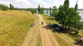 AERIAL VIEW. People Collecting Garbage On The Territory Of City Park stock video footage
