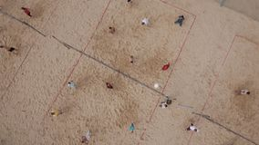 Aerial view people compete beach volleyball at sand playground on sunny day stock footage
