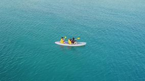 Aerial view of people paddling on the sea. Beautiful aerial view footage of people enjoying holiday by paddling on the sea in Labuan Bajo, East Nusa Tenggara stock footage