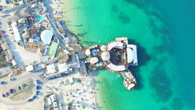 Aerial view of people partying in club on the sea water, Pag island stock video