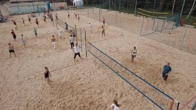 Aerial view people playing beach badminton at sand playground on sunny day stock video