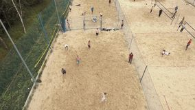 Aerial view people playing beach soccer on two fields covered with sand stock video footage