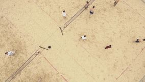 Aerial view people playing beach volleyall on two fields covered with sand stock video