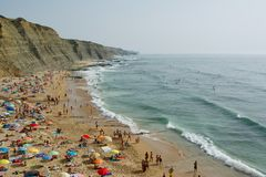 People relaxing On ocean portugal beach. Aerial View Of People Relaxing On Beach In Portugal royalty free stock photos