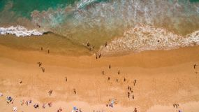Aerial view of people resting on a beautiful beach near the ocean, Portugal royalty free stock images