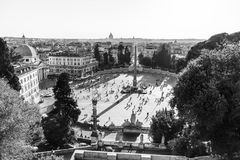 Aerial view of people, sculptures, fountain and churches on Piazza del Popolo in Rome, Italy. Stock Photo