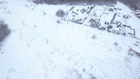 Aerial view people skiing and snowboarding on ski slope on winter ski resort. Aerial view people skiing and snowboarding on snow slope in winter ski resort. Ski stock video
