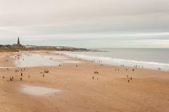 Aerial view of people strolling on beach in North Shields Stock Image