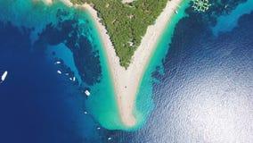 Aerial view of people sunbathing on a sandy beach on the island of Brac, Croatia