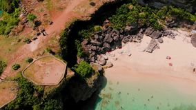 Aerial view of people swimming at the cliff area stock footage