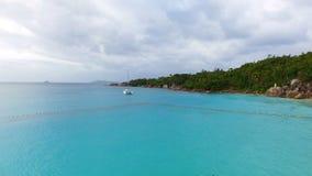 Aerial View Of People Swimming In The Ocean. Drone Shot Of People Swimming In The Indian Ocean, Anse Lazio,Praslin Island, Seychelles stock footage