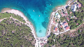 Aerial view of people swimming in turquoise water of the island of Brac, Croatia stock video