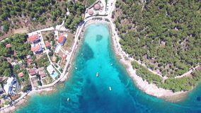 Aerial view of people swimming in turquoise waters of island of Brac, Croatia. Aerial view of people swimming and boats mooring at the turquoise bay on the stock video