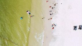 Aerial view of people by the beach stock footage