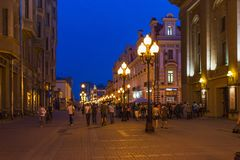 Aerial view people walk by Arbat street at summer evening. RUSSIA, MOSCOW - JUL 14, 2013: Aerial view people walk by Arbat street at summer evening. Photo with Stock Photos