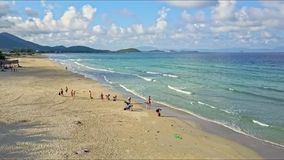 Aerial View People Walk on Wild Tropical Ocean Sand Beach stock video footage