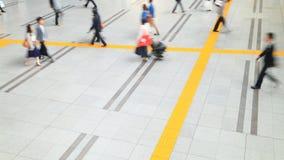 Aerial view of people walking on passageway stock footage
