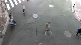 Aerial view of people walking stock video footage
