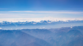 Aerial view of the Peruvian Andes, shot from aeroplane. High altitude mountain range and glaciers. Expansive view Royalty Free Stock Photography