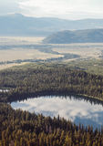 Aerial View Photo of Lake Between Green Forest Stock Photos