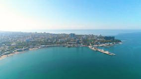 Aerial view photography over the sea port and city on a sunny day, beautiful seascape. stock video