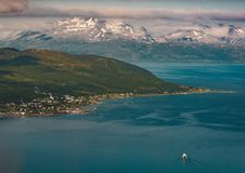 Aerial View Photography of Snow Covered Mountain Beside Ocean Royalty Free Stock Image