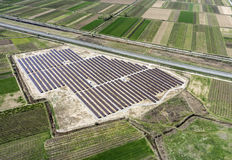 Aerial view of photovoltaic panels. Aerial view of large installation of photovoltaic panels between fields stock photography