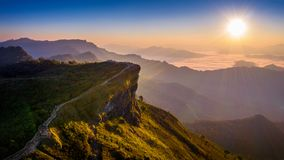 Aerial view Phu chi fa and morning fog at sunrise, Chiang rai, Thailand. royalty free stock image