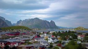 Aerial view of Reine on Lofoten islands in Norway. Aerial view of picturesque fishing town of Reine on Lofoten islands in Norway, popular tourist destination on stock video