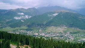 Aerial view of picturesque valley in mountains. Aerial drone flight over picturesque valley in hight mountains. Breathtaking landscape of green trees and valley stock footage