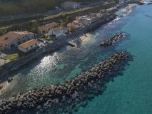 Aerial view of a pier with rocks and house close the sea. Pizzo Calabro. Calabrian coast of Southern Italy. Calabria, Italy. Aerial view of a pier with rocks and Royalty Free Stock Images