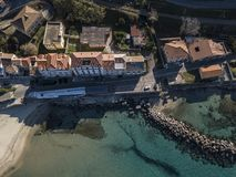 Aerial view of a pier with rocks and house close the sea. Pizzo Calabro. Calabrian coast of Southern Italy. Calabria, Italy. Aerial view of a pier with rocks and Stock Image