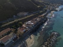 Aerial view of a pier with rocks and house close the sea. Pizzo Calabro. Calabrian coast of Southern Italy. Calabria, Italy. Aerial view of a pier with rocks and Stock Photo