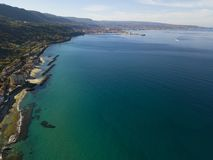 Aerial view of a pier with rocks and house close the sea. Pizzo Calabro. Calabrian coast of Southern Italy. Calabria, Italy. Aerial view of a pier with rocks and Royalty Free Stock Photo
