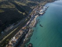Aerial view of a pier with rocks and house close the sea. Pizzo Calabro. Calabrian coast of Southern Italy. Calabria, Italy. Aerial view of a pier with rocks and Stock Images