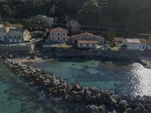 Aerial view of a pier with rocks and house close the sea. Pizzo Calabro. Calabrian coast of Southern Italy. Calabria, Italy. Aerial view of a pier with rocks and Stock Photography