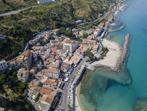 Aerial view of a pier with rocks and rocks on the sea. Pier of Pizzo Calabro, panoramic view from above. Calabria, Italy Royalty Free Stock Photos