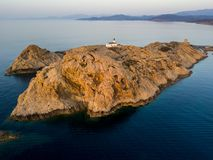 Aerial view of the Pietra Lighthouse and the Genoese tower at sunset. Red Island, Corsica, France. Aerial view of the Pietra Lighthouse at sunset and the Genoese stock photo