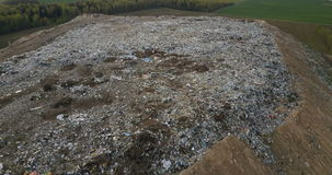 Aerial view of the pile of trash. Copter flying over the urban dump outside the city, refuse dirty waste. stock footage