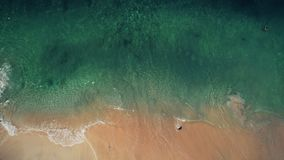 Aerial view pink sand beach and blue crystal sea stock footage