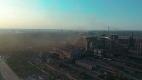 Aerial view. Pipes throwing smoke in the sky. Environmental pollution concept danger to planet earth. Aerial view. Pipes throwing smoke in the sky stock footage