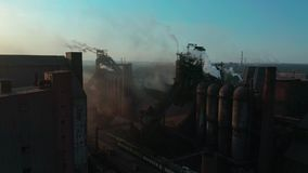 Aerial view. Pipes Throwing Smoke in the Sky. Environmental pollution concept danger to planet earth. Aerial view. Pipes Throwing Smoke in the Sky stock video