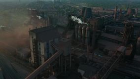 Aerial view. Pipes Throwing Smoke in the Sky. Environmental pollution concept danger to planet earth. Aerial view. Pipes Throwing Smoke in the Sky stock video footage
