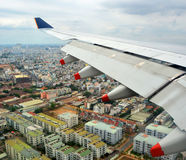 Aerial view of plane coming into land over Ho Chi Minh City. Royalty Free Stock Image